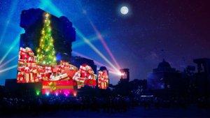 Weihnachtsbaum und Weihnachtsgeschenke auf den Tower of Terror projeziiert