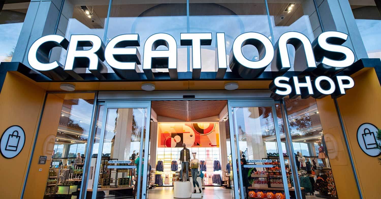Creations Shop Eingang mit leuchtenden Buchstaben