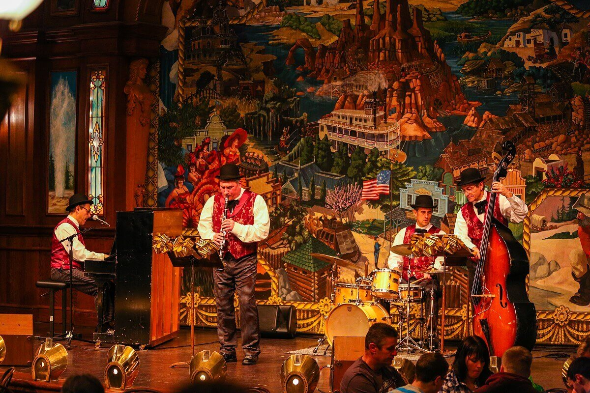 On the stage in the Lucky Nugget Saloon, a band performs and entertain the guests during the meal