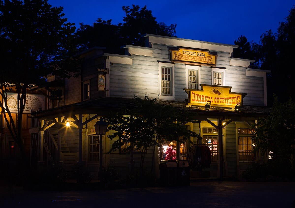 Signs on the Thunder Mesa Mercantile building are illuminated at night