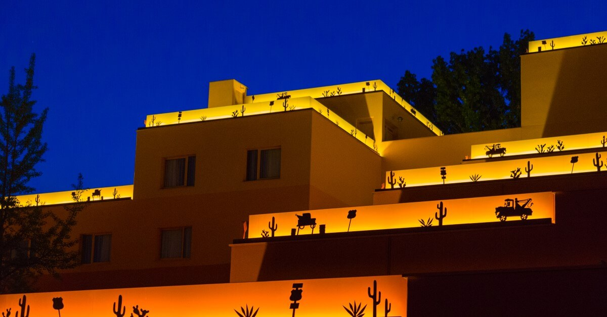 View over the rooftops of Disney's Hotel Santa Fe at night